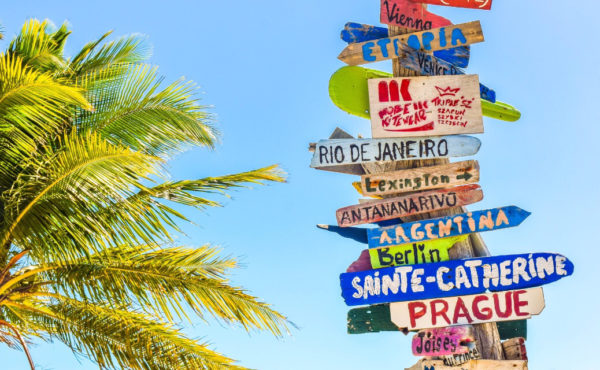 Signs with different vacation destinations around the world